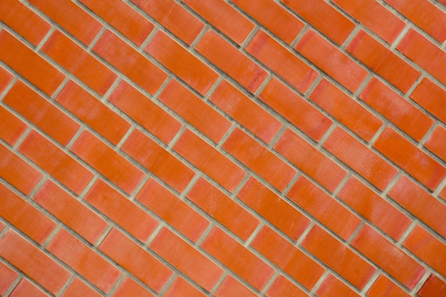 Oranje antieke bakstenen muur - achtergrond