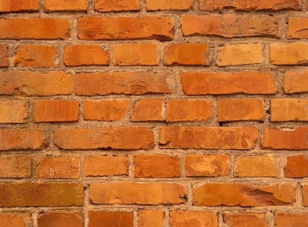 Oranje bakstenen muur. brickwall achtergrond, oude vintage textuur.