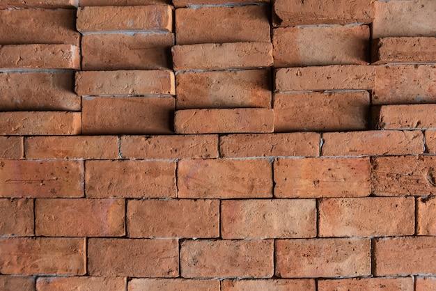 Oranje bakstenen muur voor patroon en achtergrond
