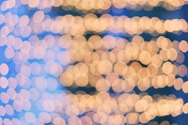Oranje bokeh, bokeh achtergrond, bokeh lichte, blauwe achtergrond en oranje bokeh