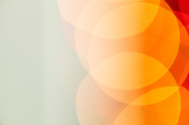 Oranje bokeh licht achtergrond