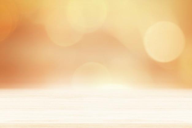 Oranje bokehmuur met beige houten vloerproductachtergrond
