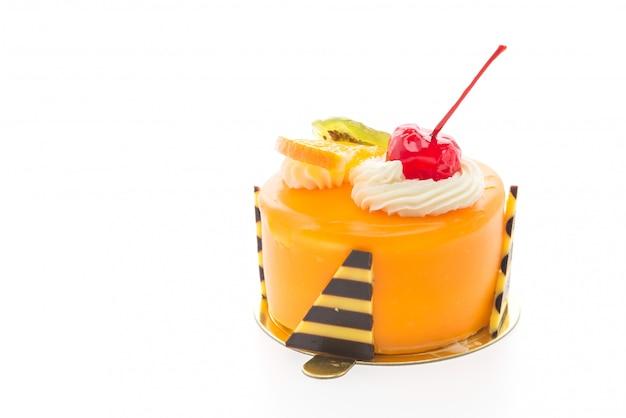 Oranje fruitcakes die op witte achtergrond worden geïsoleerd