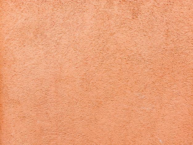 Oranje getextureerde muur