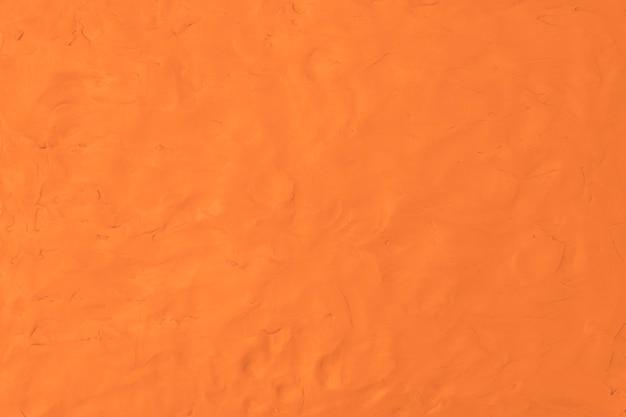 Oranje klei getextureerde achtergrond kleurrijke handgemaakte creatieve kunst abstracte stijl