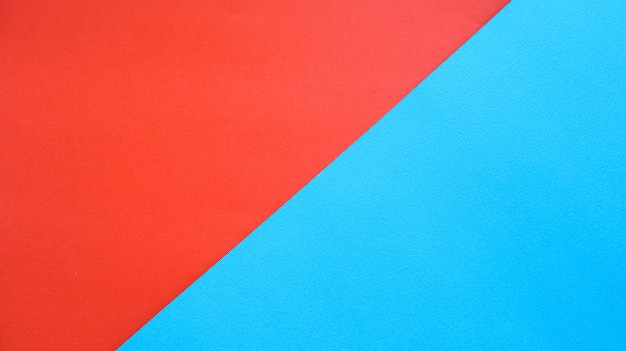 Oranje papier en blauw papier achtergrond