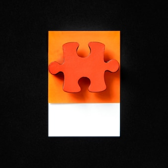 Oranje puzzelspel puzzelstukje