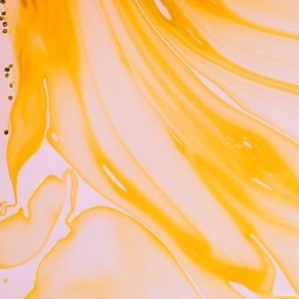 Oranje vloeistoflagen abstract ontwerp