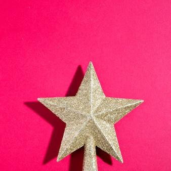 Ornament gouden ster met schaduw