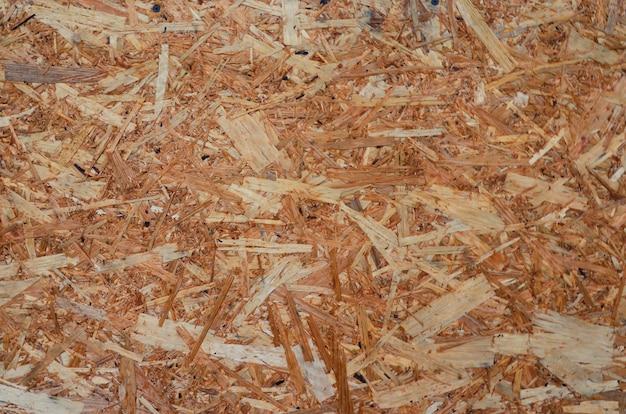 Osb houten paneel gemaakt van geperste houtsnippers als close-up achtergrond