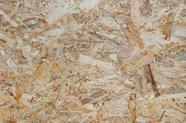 Osb-platen zijn gemaakt van houtsnippers. bovenaanzicht osb fineer achtergrond.