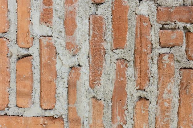 Oud bakstenen muur dicht omhoog beeld voor achtergrond.