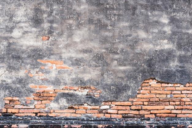 Oud bakstenenpatroon en gebarsten concrete muur voor abstracte achtergrond.