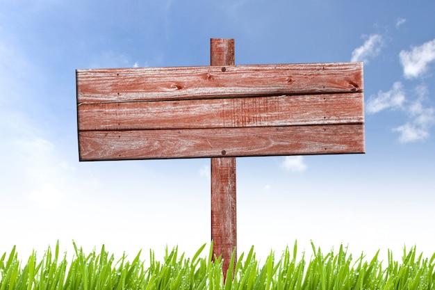 Oud doorstaan houten teken op aardachtergrond