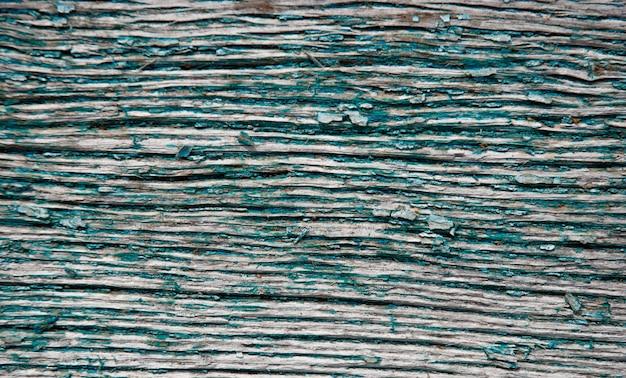 Oud hout. achtergrond van oude raad en gebarsten verf.