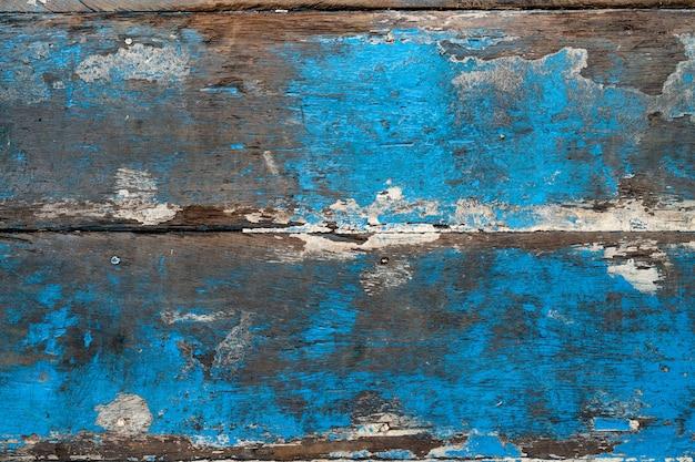 Oud hout dat op blauw, textuur of achtergrond wordt geschilderd
