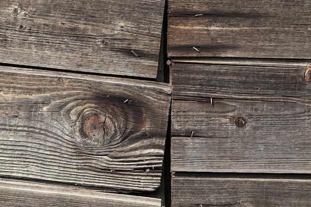 Oud houtoppervlak na het inloggen van hout, close-up van hout dat werd gebruikt in de bouw