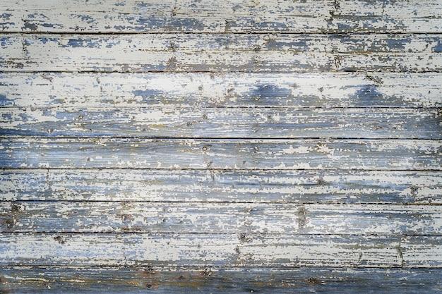 Oud licht houten bord met horizontale strepen