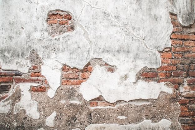Oude bakstenen muur met cement textuur achtergrond.