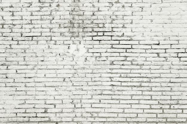 Oude bakstenen muur met witte verf achtergrondtextuur
