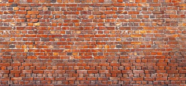 Oude bakstenen muurachtergrond, textuur van rood metselwerk.