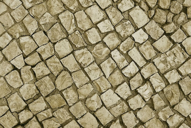 Oude beige stenen bestrating achtergrond