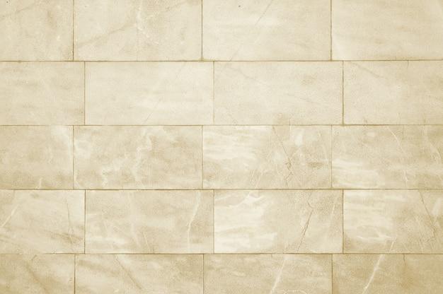 Oude beige stenen muur textuur