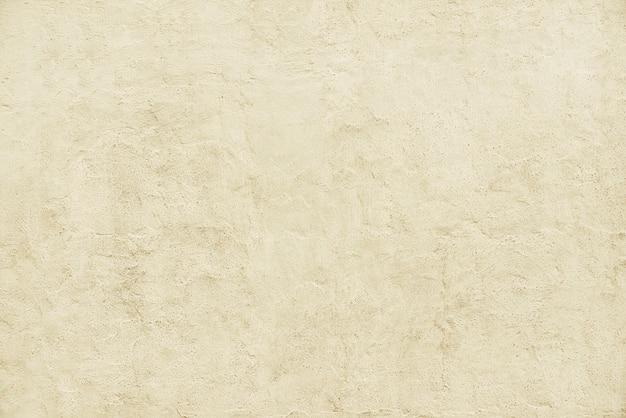 Oude beige van de steenmuur textuur als achtergrond