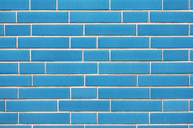 Oude blauwe bakstenen muur textuur achtergrond