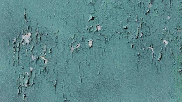 Oude blauwe muur met gevallen verf