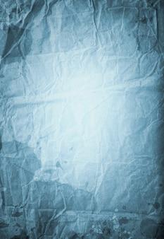 Oude blauwe vintage achtergrond, textuur van verfrommeld verschoten papier, vlekken en strepen, designpapier, ruimte voor tekst