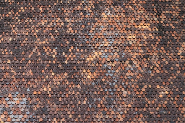 Oude bruine het patroon van de daktegel textuur als achtergrond