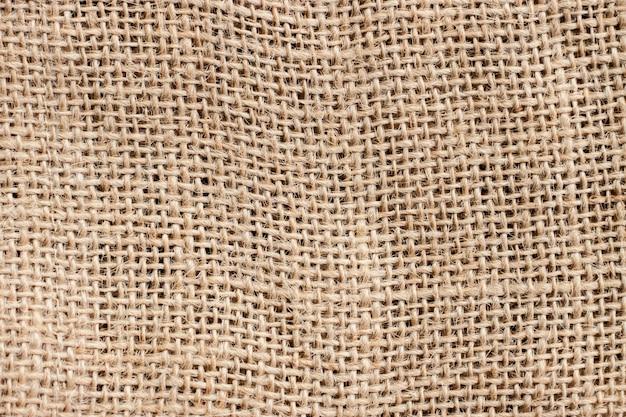 Oude bruine jutetextuur en achtergrond, detail van de patroon het abstracte uitstekende stof.