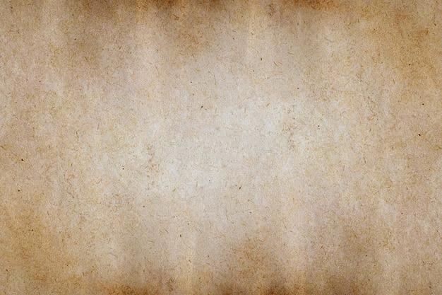 Oude bruine papieren grunge textuur achtergrond.