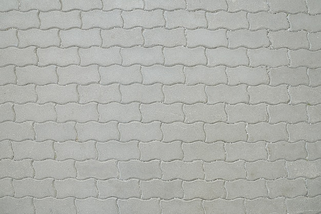 Oude de bestratingstextuur van het weg grijze mozaïek