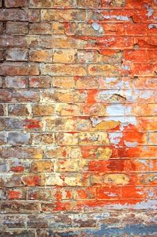 Oude gebarsten bakstenen muurtextuur
