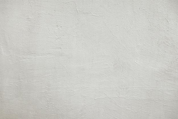 Oude gebarsten grijze muurtextuur als achtergrond