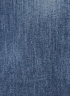 Oude gebruikte blauwe denim textuur close-up achtergrond