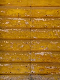 Oude geelbruine rode deuren houtstructuur