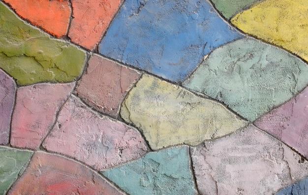 Oude gekleurde de textuurachtergrond van de steenmuur
