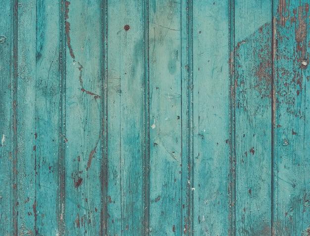 Oude geschilderde cracky blauwe turquoise houten textuur. vintage rustiek