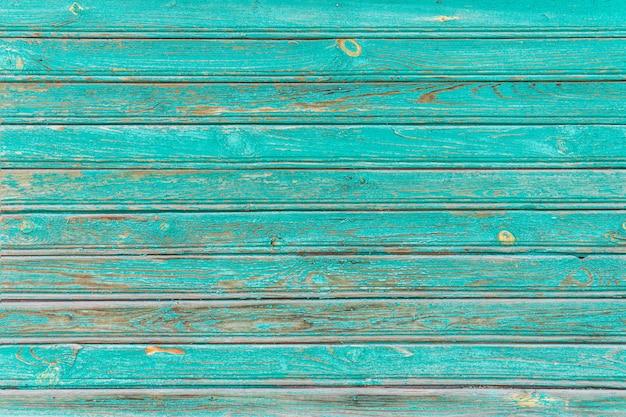 Oude geschilderde gebarsten planken, bovenaanzicht. hout textuur.