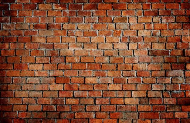 Oude getextureerde bakstenen muur achtergrond