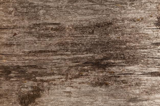 Oude geweven houten oppervlak met scheuren en roestige spijker. natuurlijke achtergrond van lariksborden.
