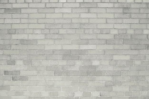 Oude grijze bakstenen muurtextuur als achtergrond