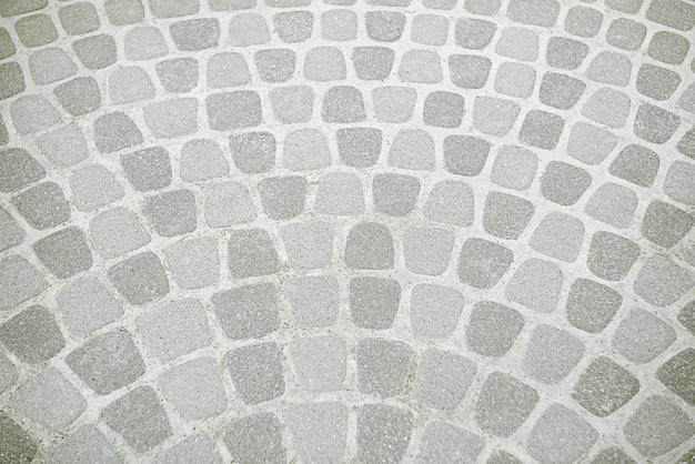Oude grijze bestrating textuur achtergrond