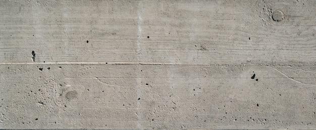 Oude grijze betonnen muur. concrete textuur, close-up. tafel textuur van moderne grijze betonnen wand. muur gemaakt van blokken. het patroon van gepleisterde kolommen. eerlijke onder ogen gezien concrete naadloze textuur.