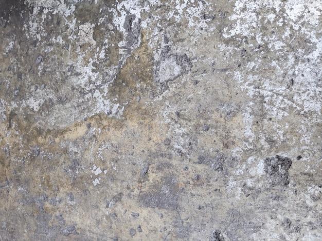 Oude grijze roestige muur
