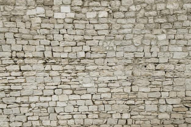 Oude grijze stenen muur achtergrond