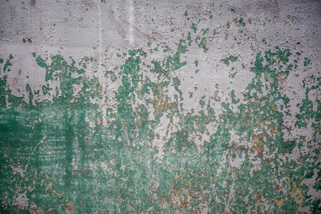 Oude groene metalen oppervlak met gebarsten verf textuur close-up achtergrond